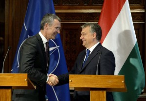 NATO Secretary General Jens Stoltenberg, left, and Hungarian Prime Minister Viktor Orban shake hands during a joint press conference in the Parliament building in Budapest, Hungary, Thursday, Nov. 19, 2015. (Noemi Bruzak/MTI via AP)