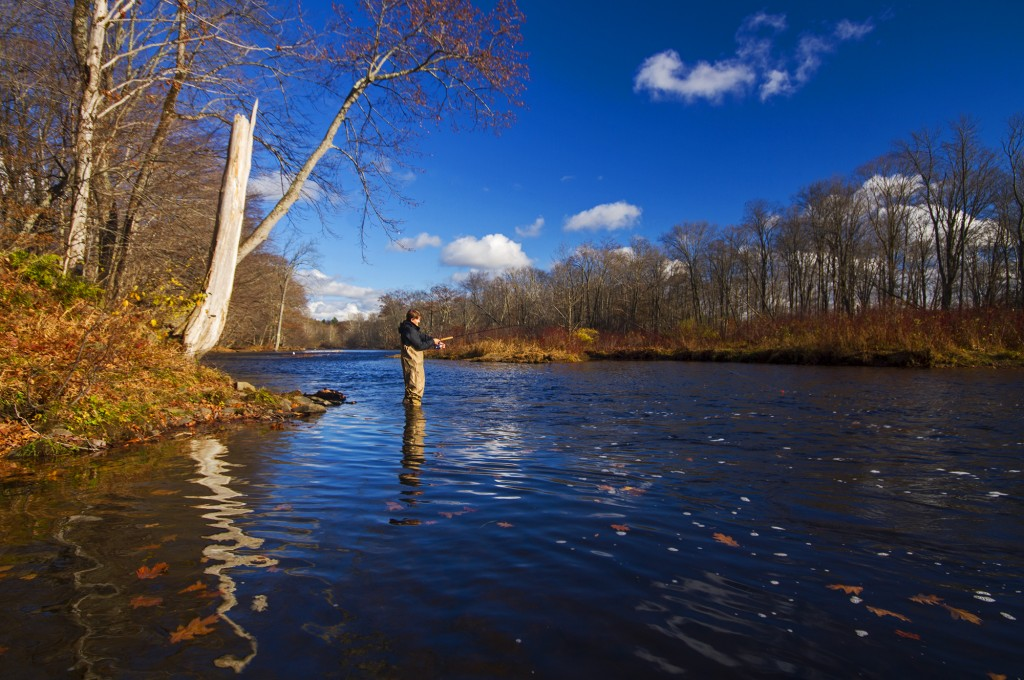 Fishing on a glorious day last month on the Salmon River in upstate New York, helping contribute $5 billion to the state economy. (Matt Champlain/Flickr)