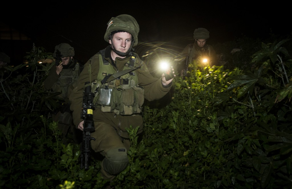 Israeli soldiers seen patrolling after three rockets were fired at northern Israel from Lebanese territory on December 20, 2015, landing in unpopulated areas and causing no injuries. (Meir Vaknin/Flash90)
