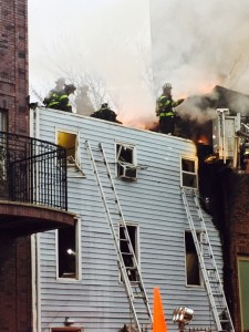Firefighters on the roof of 274 Skillman Street in Williamsburg. (JG)