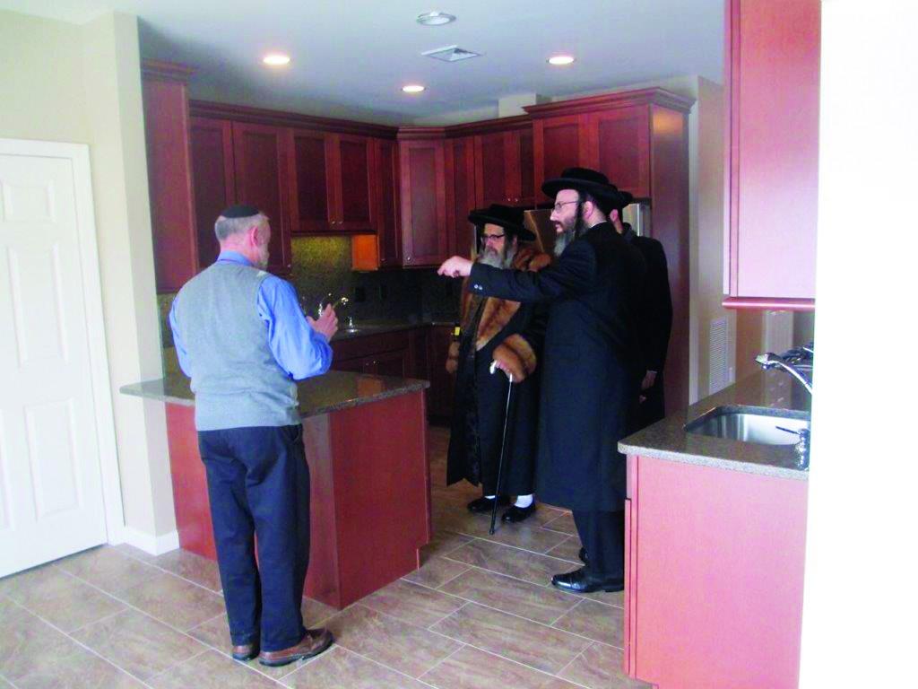 Satmar Rebbe Harav Zalman Leib Teitelbaum visits a new home in Bloomingburg.