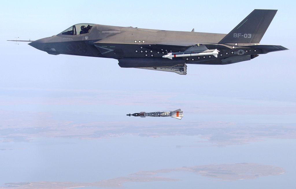 The F-35B, internal bay test release of a GBU-12 Paveway II 500 lb bomb. Also visible is an external AIM-9 Sidewinder and an AIM-120 AMRAAM, 2012. (U.S. Navy)