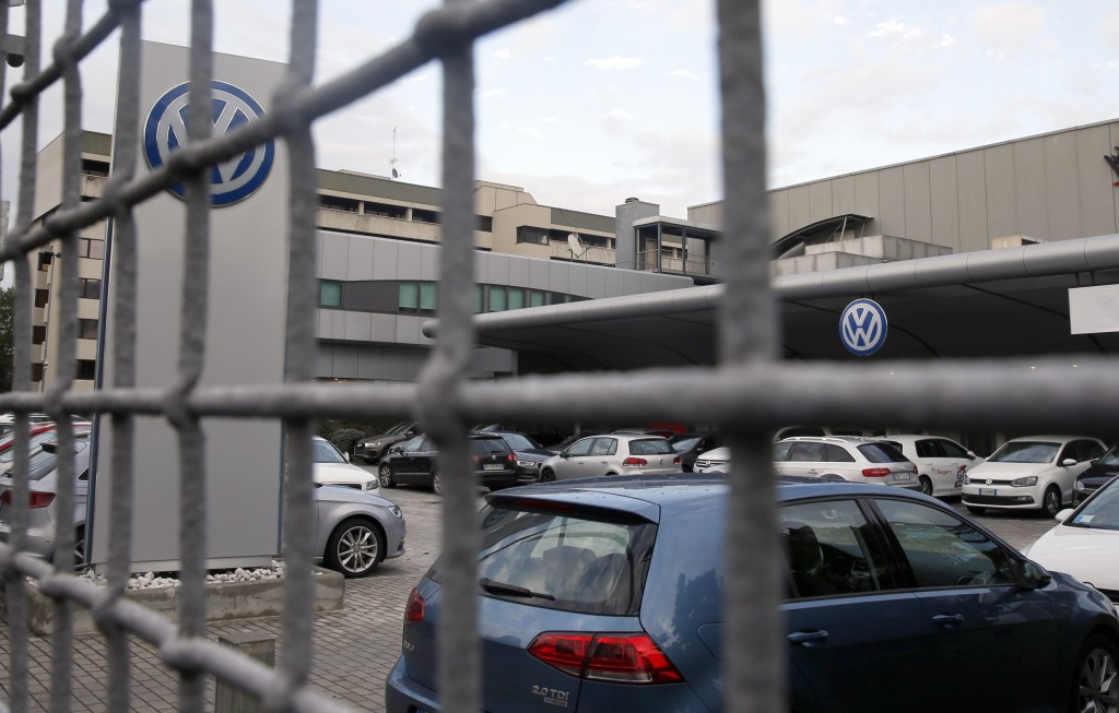 Cars are parked at a Volkswagen dealer in Milan, Italy. (AP Photo/Luca Bruno)