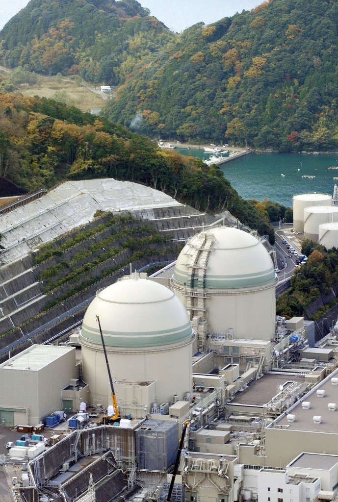 This photo taken in November, 2014, shows No. 3, left, and No. 4 reactors at a nuclear power plant in Takahama, Fukui prefecture, western Japan. A Japanese court has given the go-ahead for the restart of the two nuclear reactors after its operator said in an appeal they were safe. The lifting of the injunction on Thursday, Dec. 24, 2015 paves the way for a resumption of the Takahama No. 3 and No. 4 reactors, operated by the Kansai Electric Power Co. (Kyodo News via AP) JAPAN OUT, MANDATORY CREDIT