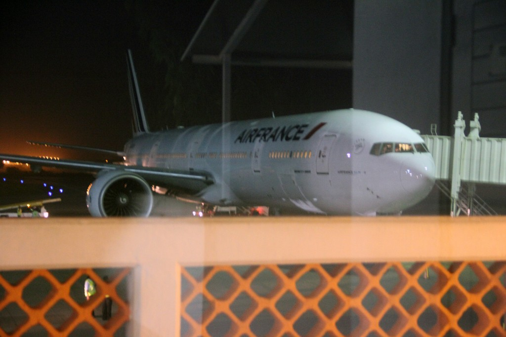 An Air France plane which arrived at Moi International Airport, Mombasa, Kenya Sunday Dec. 20, 2015 to pick passengers after a bomb scare on their earlier flight from Mauritius. (AP Photo)