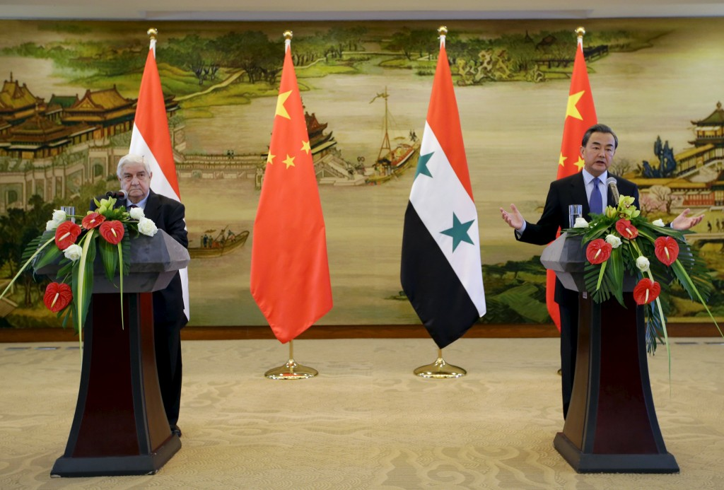 China's Foreign Minister Wang Yi (R) speaks during a joint news conference with Syria's Foreign Minister Walid al-Moualem after a meeting at the Ministry of Foreign Affairs in Beijing, China, December 24, 2015. REUTERS/Jason Lee