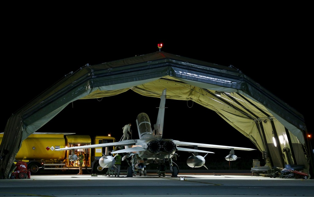 RAF personnel work on a British Tornado after it returned from a mission at RAF Akrotiri in southern Cyprus December 3, 2015. REUTERS/Darren Staples TPX IMAGES OF THE DAY
