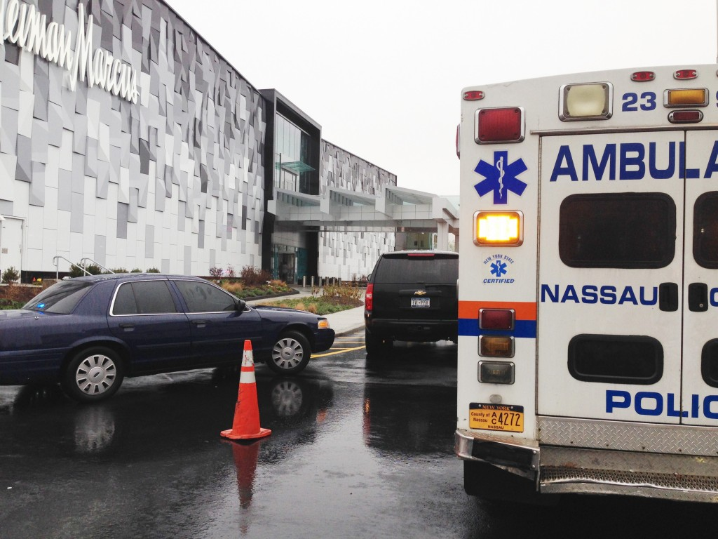 An ambulance is staged outside the Roosevelt Field Mall Tuesday afternoon. (AP Photo/Frank Eltman)