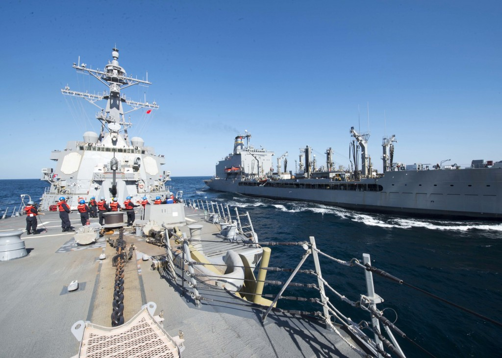In this Thursday, Dec. 24, 2015 photo released by the U.S. Navy, guided-missile destroyer USS Bulkeley participates in a replenishment-at-sea with fleet replenishment oiler USNS John Lenthall in the Gulf of Oman. Iranian naval vessels conducted rocket tests last week near the USS Harry S. Truman aircraft carrier, the USS Bulkeley destroyer and a French frigate, the FS Provence, and commercial traffic passing through the Strait of Hormuz, the American military said Wednesday, Dec. 30, 2015 causing new tension between the two nations after a landmark nuclear deal. (Mass Communication Specialist 2nd Class M. J. Lieberknecht/ U.S. Navy via AP) MANDATORY CREDIT