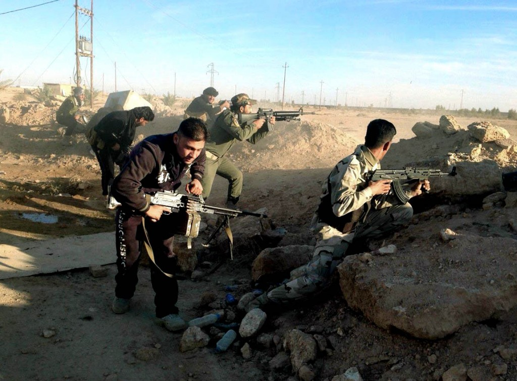 Iraqi security forces take combat positions on the front line with Islamic State group militants in Ramadi, capital of Iraq's Anbar province, 70 miles (115 kilometers) west of Baghdad, Thursday, Dec. 10, 2015. Following significant advances on the Anbar provincial capital Ramadi Tuesday, Iraqi forces are now preparing to push into the city center from the southwest and the north. Tuesday's advances, the most significant incursion into Ramadi since the city fell to the Islamic State group in May, have placed Iraqi forces along the southwest edge of Ramadi in the Tamim neighborhood and just north of the city at the former Anbar operations command. (AP Photo/Osama Sami)