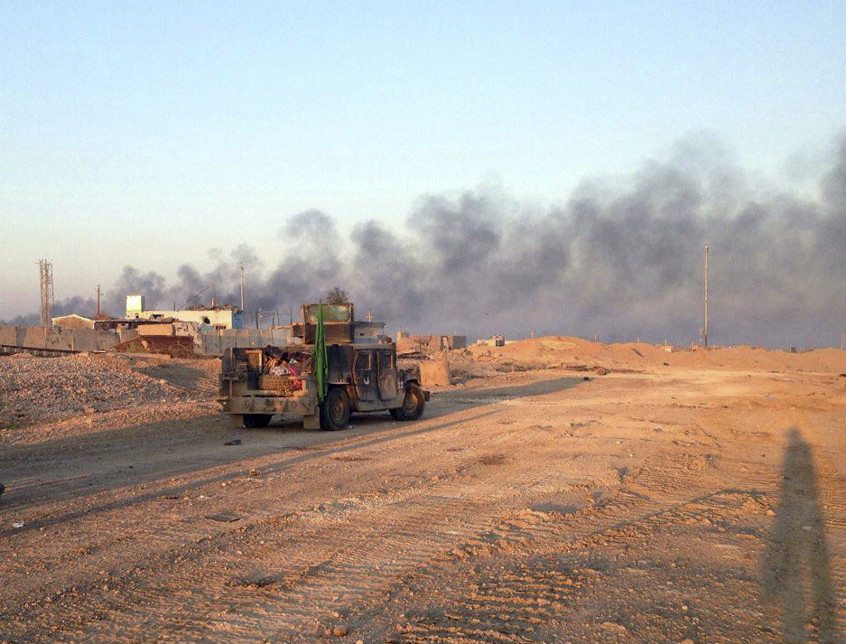 Smoke rises from Islamic State positions following a U.S.-led coalition airstrike as Iraqi Security forces advance their position in Ramadi, 70 miles (115 kilometers) west of Baghdad, Iraq, Tuesday, Dec. 22, 2015. Iraqi forces on Tuesday reported progress in the military operation to retake the city of Ramadi from the Islamic State group, saying they made the most significant incursion into the city since it fell to the militants in May. (AP Photo/Osama Sami)