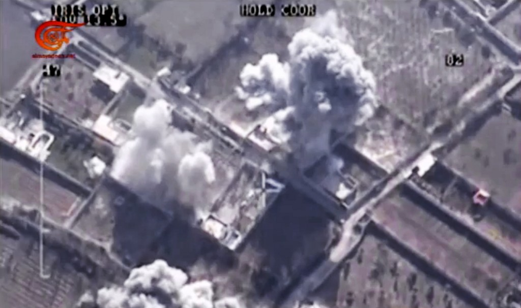 This image made from video made available on Saturday, Dec. 26, 2015, by Al-Mayadeen, government-controlled Syrian media, which has been verified and is consistent with other AP reporting, showsdrone footage allegedly showing airstrikes targeting Zahran Allouch, the head of the Army of Islam group near Damascus, Syria. (Al-Mayadeen via AP video)