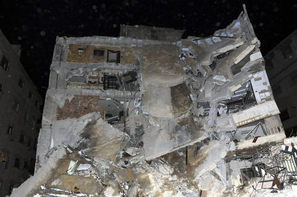 This photo released Sunday, Dec. 20, 2015, by the Syrian official news agency SANA shows the damaged building where Samir Kantar was believed to be killed along with several others Saturday night in the Damascus suburb of Jaramana, Syria. Kantar a Lebanese who was convicted of executing one of the most notorious attacks in Israeli history and spent nearly three decades in an Israeli prison, has been killed in an Israeli airstrike that targeted a residential building near the Syrian capital, the Lebanese Shiite Hezbollah group said Sunday. (SANA via AP)