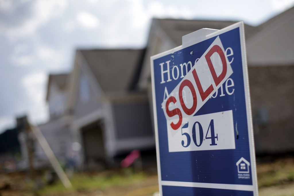 FILE - This June 4, 2015, file photo, shows a sign indicating a site has been sold in a new home development in Nashville, Tenn. Mortgage buyer Freddie Mac said Thursday, Dec. 10, 2015, that average long-term U.S. mortgage rates edged higher during the week following three straight weeks of declines, amid expectations that the Federal Reserve will raise its key short-term interest rate next week. (AP Photo/Mark Humphrey, File)
