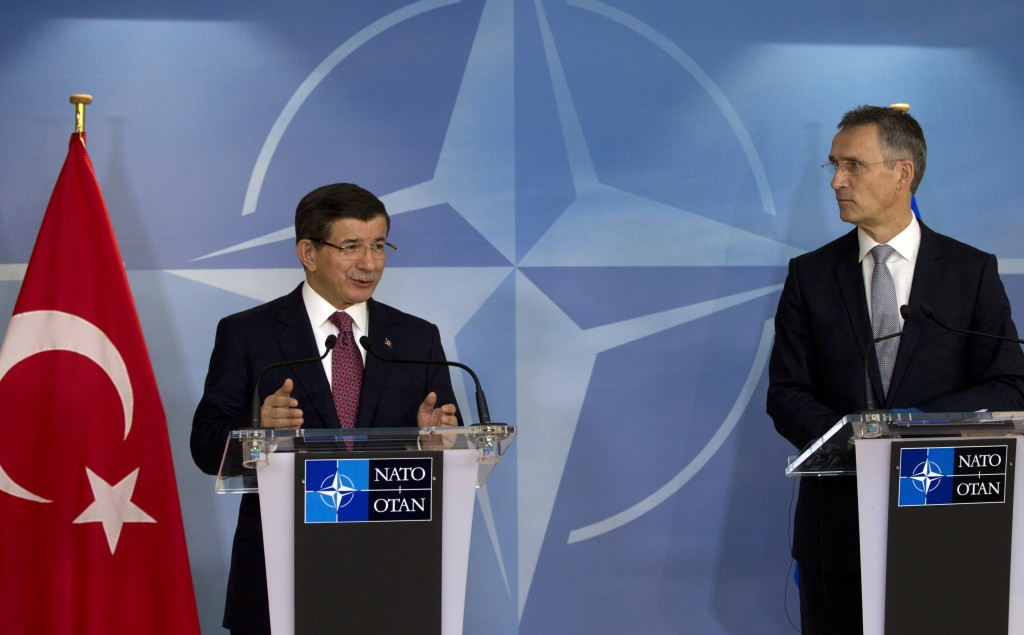 Turkish Prime Minister Ahmet Davutoglu, left, and NATO Secretary General Jens Stoltenberg address a media conference at NATO headquarters in Brussels on Monday, Nov. 30, 2015. NATO Secretary General Jens Stoltenberg met with the Turkish prime minister on Monday to discuss the issue of a Russian warplane downed by a Turkish fighter jet at the border with Syria. (AP Photo/Virginia Mayo)