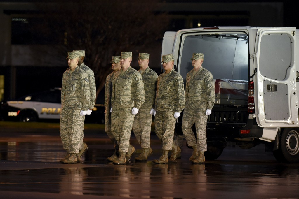 A U.S. Air Force carry team moves in unison after placing a transfer case with the remains of fallen Staff Sgt. Chester J. McBride of Statesboro, Georgia, into a vehicle during a dignified transfer at the New Castle Air National Guard Base in New Castle, Delaware, December 23, 2015. McBride was one of the six U.S. troops killed by a suicide bomber near Bagram air base in Afghanistan. REUTERS/Doug Curran EDITORIAL USE ONLY. NO RESALES. NO ARCHIVE