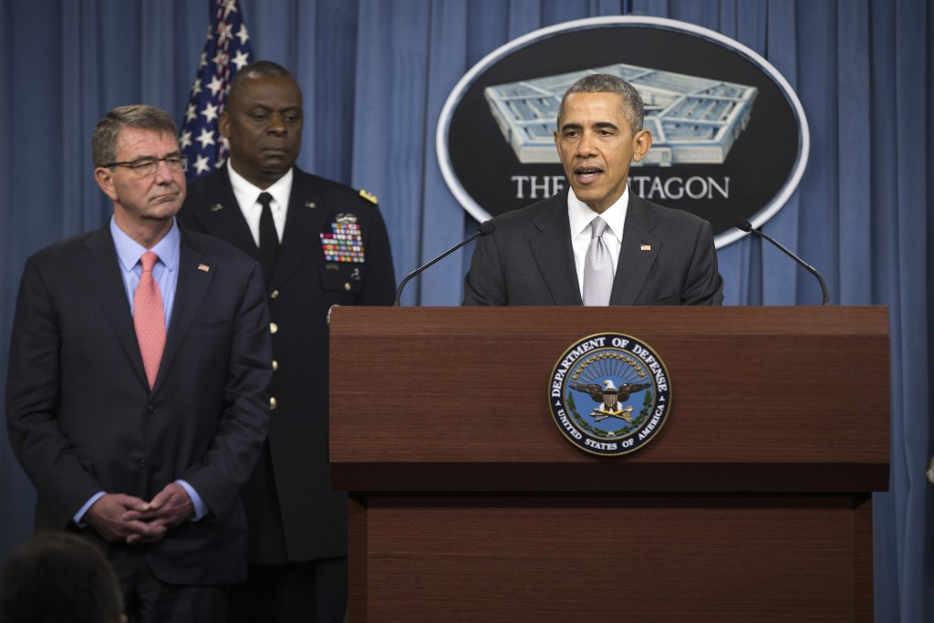 Defense Secretary Ash Carter, left, and Commander of U.S. Central Command Gen. Lloyd Austin, center, listen as President Barack Obama speaks at the Pentagon, Monday, Dec. 14, 2015,  on the fight against the Islamic State group following a National Security Council meeting. (AP Photo/Evan Vucci)