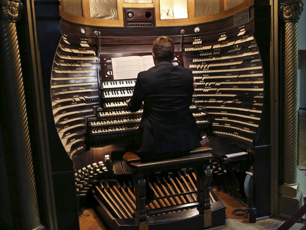 Steven Ball, staff organist with the Historic Organ Restoration Committee, plays the console of the huge Boardwalk Hall organ in Atlantic City, N.J. (AP Photo/Mel Evans)