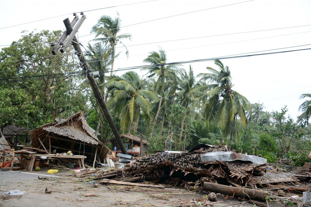 Damaged houses and debris are seen after strong winds and heavy rains brought by typhoon Melor battered Gubat town, Sorsogon province, central Philippines December 15, 2015. Wide areas of the central Philippines were plunged into darkness on Tuesday as powerful typhoon Melor barreled into the coconut-growing region, causing flooding, storm surges and forcing almost 800,000 people to evacuate their homes, officials said. REUTERS/Renelyn Loquinario EDITORIAL USE ONLY. NO RESALES. NO ARCHIVES.
