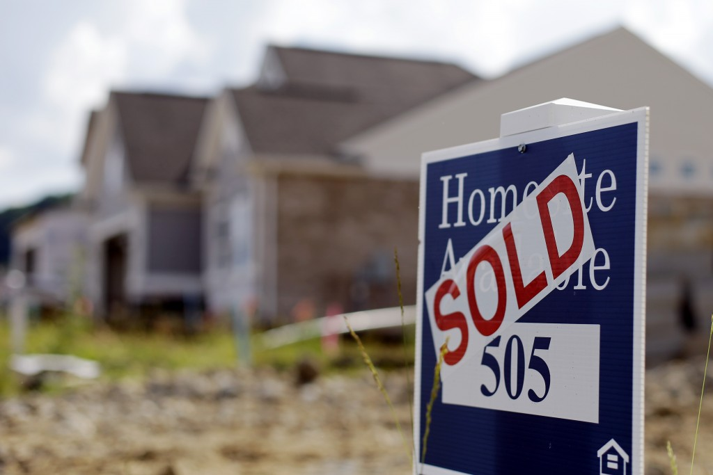 This June 4, 2015, photo shows a sold sign posted at a new home development in Nashville, Tenn. The National Association of Realtors releases its May report on pending home sales, which are seen as a barometer of future purchases, on Monday, June 29, 2015. (AP Photo/Mark Humphrey)