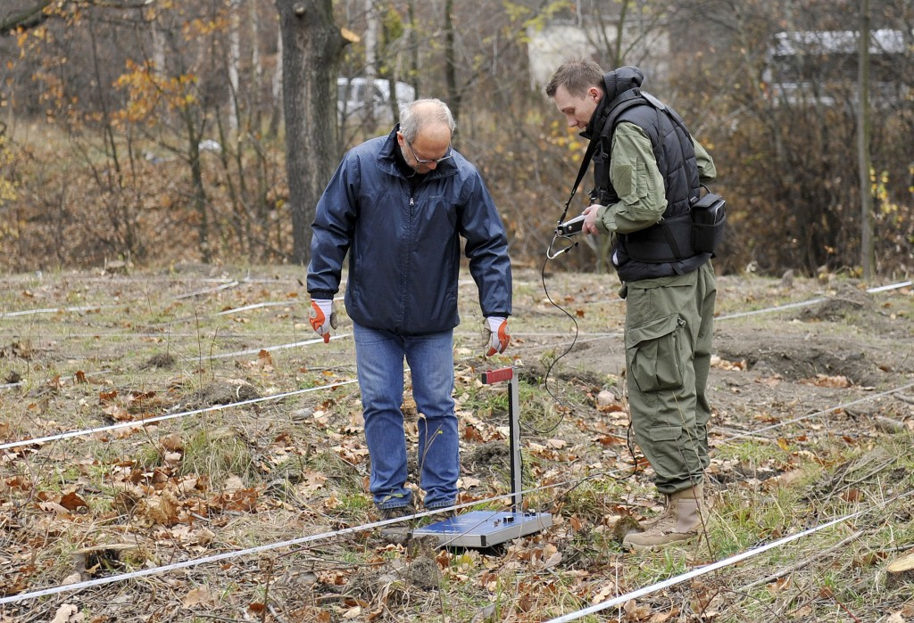 FILE - In this Nov.10 , 2015 file photo experts with an earth-penetrating radar check the area where, according to two explorers, a secret tunnel is allegedly hiding a World War II Nazi train with armaments and precious minerals, in Walbrzych, southwestern Poland. Local lore says the train is laden with gold and valuables. (AP Photo/Natalia Dobryszycka, file) POLAND OUT
