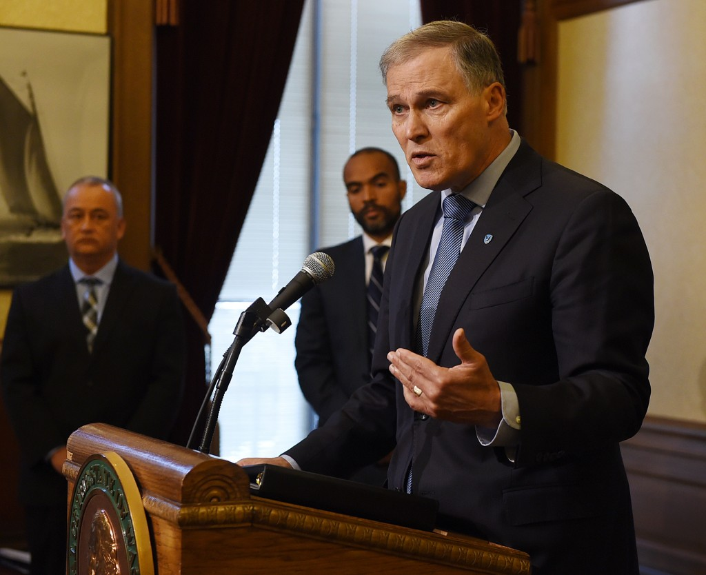 Washington Gov. Jay Inslee speaks during a news conference in Olympia, Wash., Tuesday, Dec. 22, 2015. More than 3,000 prisoners in Washington have been mistakenly released early since 2002 because of an error by the state's Department of Corrections. Inslee said he had ordered immediate steps to correct the long-standing problem. (Steve Bloom/The Olympian via AP) MANDATORY CREDIT