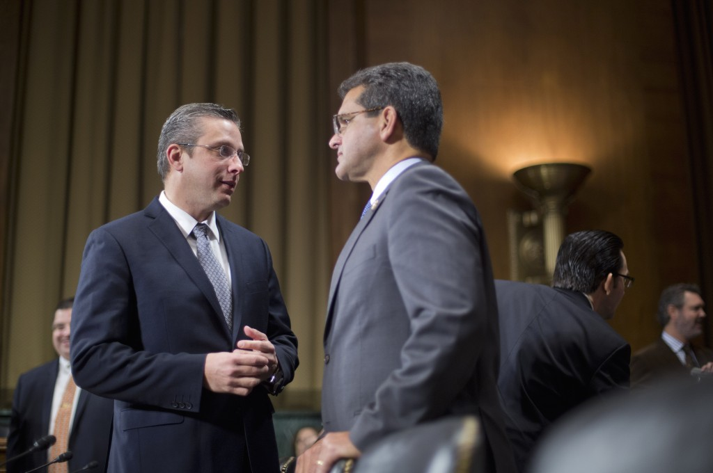 Puerto Rico Gov. Alejandro Javier Garcia Padilla, left, confers with House of Representatives Resident Commissioner for Puerto Rico Pedro Pierluisi, on Capitol Hill in Washington, Tuesday, Dec. 1, 2015, prior to testifying before the Senate Judiciary Committee hearing on Puerto Rico's fiscal problems. Puerto Rico and its debt crisis takes center stage in Congress as its governor testifies before a Senate panel about the U.S. commonwealth's financial woes and the demands of creditors.(AP Photo/Pablo Martinez Monsivais)
