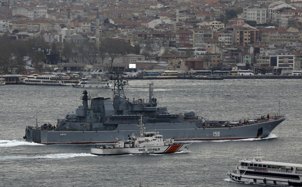 The Russian Navy large landing ship Yamal is escorted by a Turkish Navy Coast Guard boat as it sets sail in the Bosphorus, on its way to the Mediterranean Sea, in Istanbul, Turkey, December 9, 2015. REUTERS/Murad Sezer