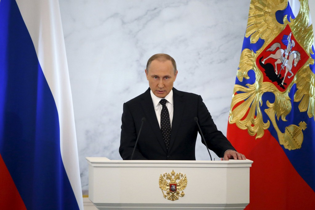 "Russian President Vladimir Putin addresses the Federal Assembly, including State Duma deputies, members of the Federation Council, regional governors and civil society representatives, at the Kremlin in Moscow, Russia, December 3, 2015. Turkey will regret ""more than once"" about its shooting down of a Russian bomber jet near the Syrian-Turkish border, Putin said on Thursday, adding Moscow would not ignore Ankara's ""aiding of terrorists"". REUTERS/Sergei Karpukhin"