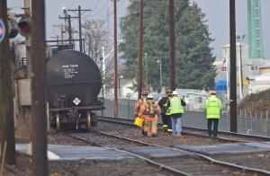 Crews mop up after Sunday's fire. (AP Photo/Craig Mitchelldyer)