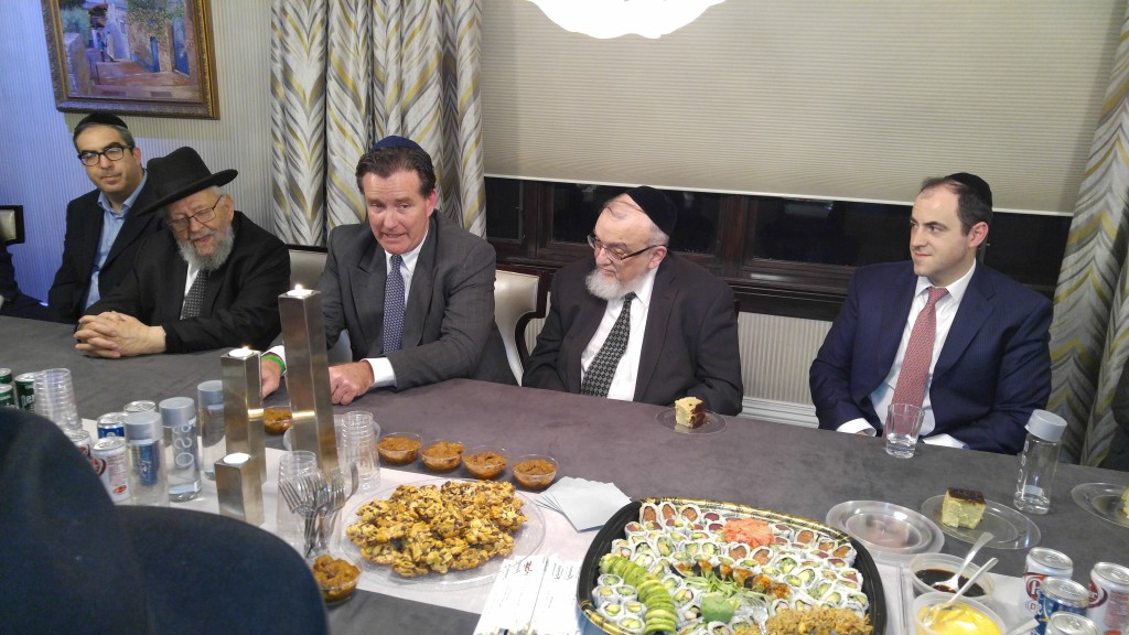 New York State Senate Majority Leader John Flanagan (R-Suffolk) speaking in the Lawrence home of Yoel Edelstein, an Agudath Israel of America trustee, on Thursday night. (Yosef Rapaport)