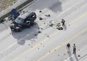 Law-enforcement officers look over the evidence near the remains of the SUV involved in the Wednesdays attack is shown in San Bernardino, California December 3, 2015. (Reuters/Mario Anzuoni)