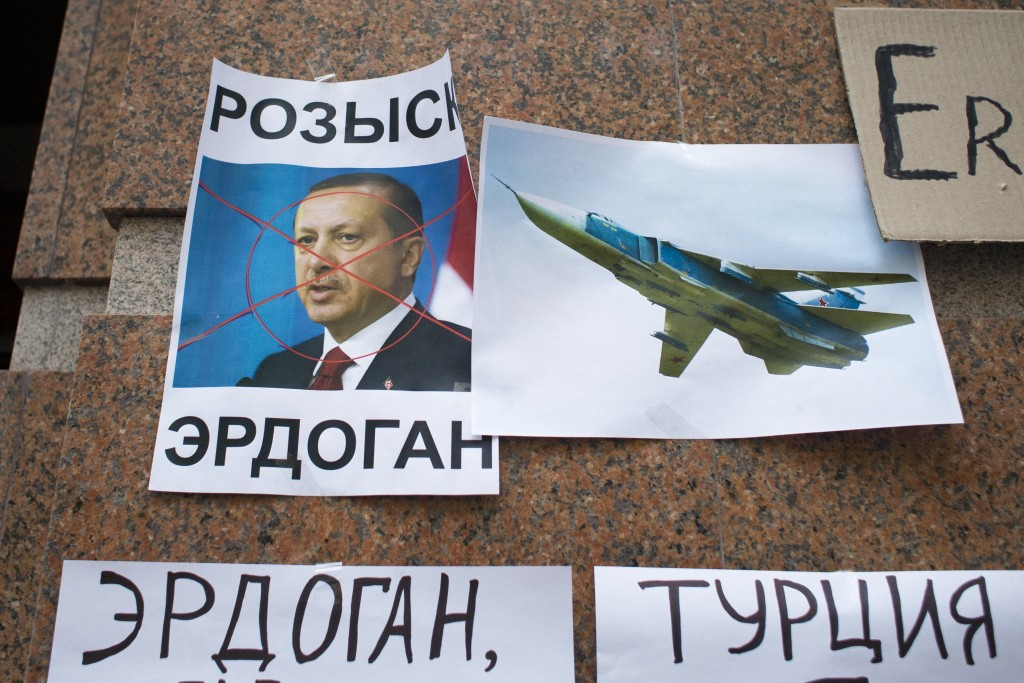 "Posters showing a portrait of Turkish President Recep Tayyip Erdogan and reading ""Wanted,"" ""Erdogan, Turkey,"" are left after a protest at the Turkish Embassy in Moscow, Russia, Wednesday, Nov. 25, 2015. Protesters have hurled eggs and stones at the Turkish embassy in Moscow a day after Turkey shot down a Russian warplane Tuesday near the Syrian border. (AP Photo/Ivan Sekretarev)"