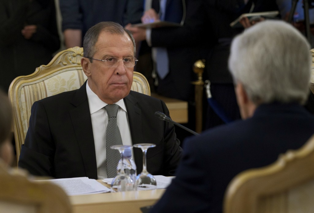 Russian Foreign Minister Sergey Lavrov listens to U.S. Secretary of State John Kerry, right, during their meeting in Moscow Tuesday, Dec. 15, 2015. Kerry arrives in Moscow to hold talks with Lavrov and Russian President Vladimir Putin. (AP Photo/Ivan Sekretarev)