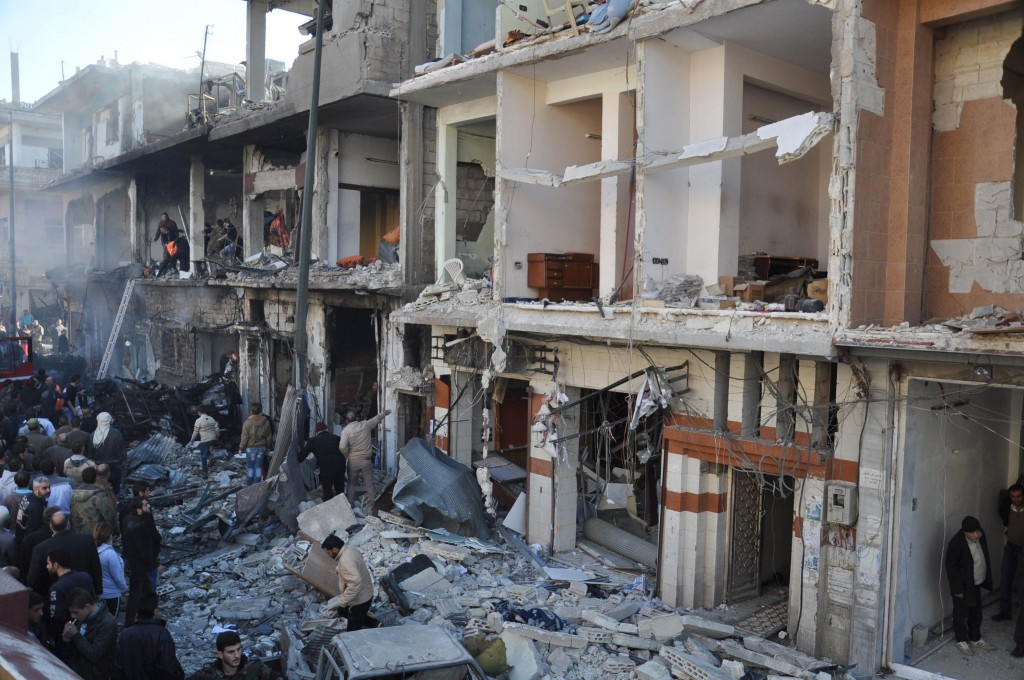 Syrian army soldiers and civilians inspect the site of two bomb explosions in the Syrian city of Homs, Syria, in this handout picture provided by SANA on December 28, 2015. REUTERS/SANA/Handout via Reuters ATTENTION EDITORS - THIS PICTURE WAS PROVIDED BY A THIRD PARTY. REUTERS IS UNABLE TO INDEPENDENTLY VERIFY THE AUTHENTICITY, CONTENT, LOCATION OR DATE OF THIS IMAGE. FOR EDITORIAL USE ONLY. NOT FOR SALE FOR MARKETING OR ADVERTISING CAMPAIGNS. THIS PICTURE IS DISTRIBUTED EXACTLY AS RECEIVED BY REUTERS, AS A SERVICE TO CLIENTS      TPX IMAGES OF THE DAY