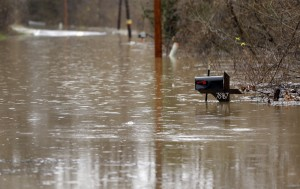 A mailbox sits along a flooded road Monday in Eureka, Mo. (AP Photo/Jeff Roberson)
