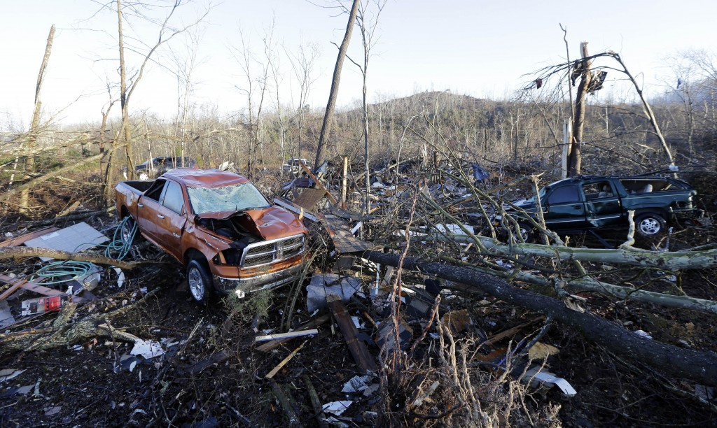 Vehicles and debris are scattered in an area near Linden, Tenn. (AP Photo/Mark Humphrey)