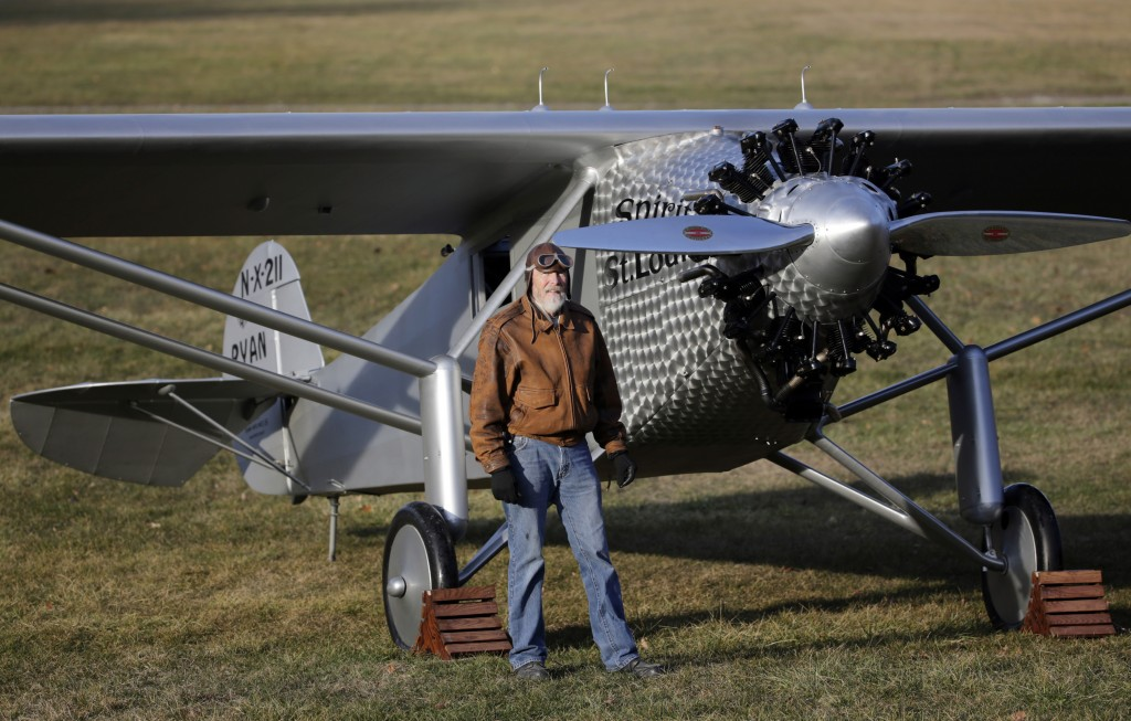 Pilot Ken Cassens poses with a Spirit of St. Louis replica before flying it at Old Rhinebeck Aerodrome last week Sunday. (AP Photo/Mike Groll)
