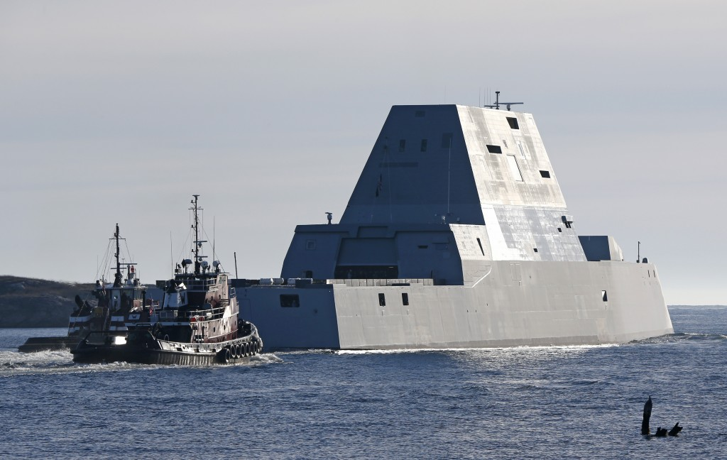 The first Zumwalt-class destroyer, the USS Zumwalt, the largest ever built for the U.S. Navy, leaves the Kennebec River, Monday, Dec. 7, 2015, in Phippsburg, Maine. (AP Photo/Robert F. Bukaty)