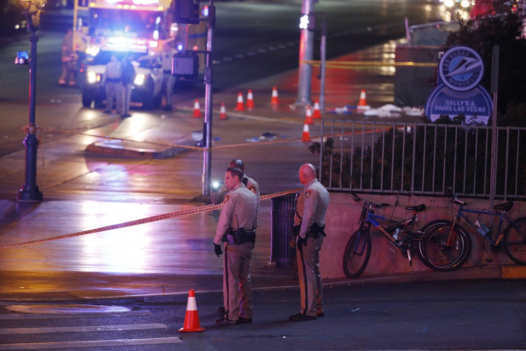 Police and emergency crews respond to the scene of Sunday's night's incident on the Las vegas Strip. (AP Photo/John Locher)