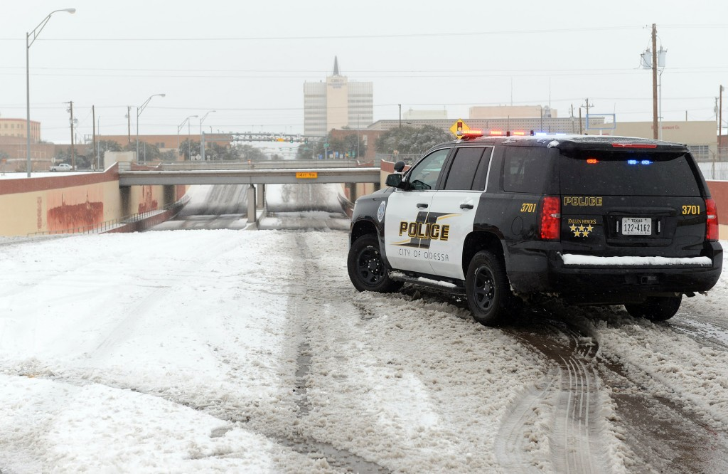 Police block access to a railroad underpass in Odessa, Texas, on Sunday. Nearly all of Interstate 40 in Texas, the main east-west highway through the Texas Panhandle, was shut. (Mark Sterkel/Odessa American via AP)