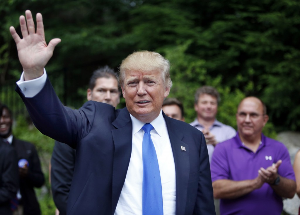 photo, Republican presidential candidate Donald Trump waves as he arrives at a house party in Bedford, N.H. Alex Nogales, president of the National Hispanic Media Coalition, said Thursday, July 9, 2015, that more organizations need to follow the example of NBC and cut business ties with Trump. (AP Photo/Jim Cole, File)