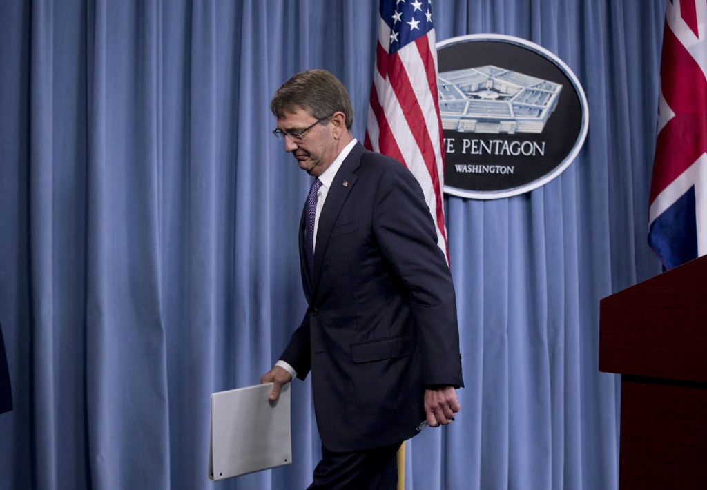 Secretary of Defense Ash Carter concludes a joint news conference with British Secretary of State for Defense Michael Fallon, at the Pentagon, Friday, Dec. 11, 2015. (AP Photo/Manuel Balce Ceneta)