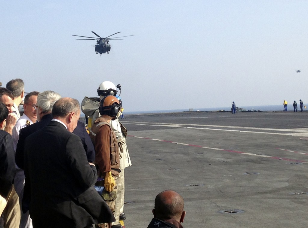 The helicopter carrying U.S. Secretary of Defense Ash Carter arrives on the French aircraft carrier Charles de Gaulle in the Persian Gulf Saturday, Dec. 19, 2015. (AP Photo/Lolita Baldor)
