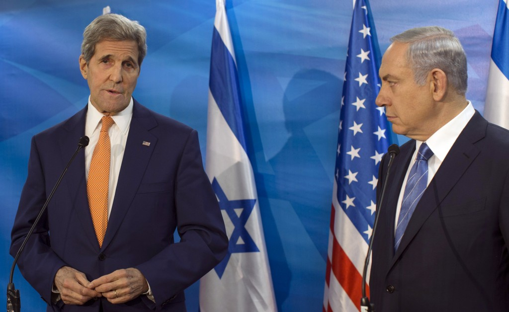 Israel's Prime Minister Benjamin Netanyahu, right, looks at U.S. Secretary of State John Kerry. (Atef Safadi/Pool via AP)