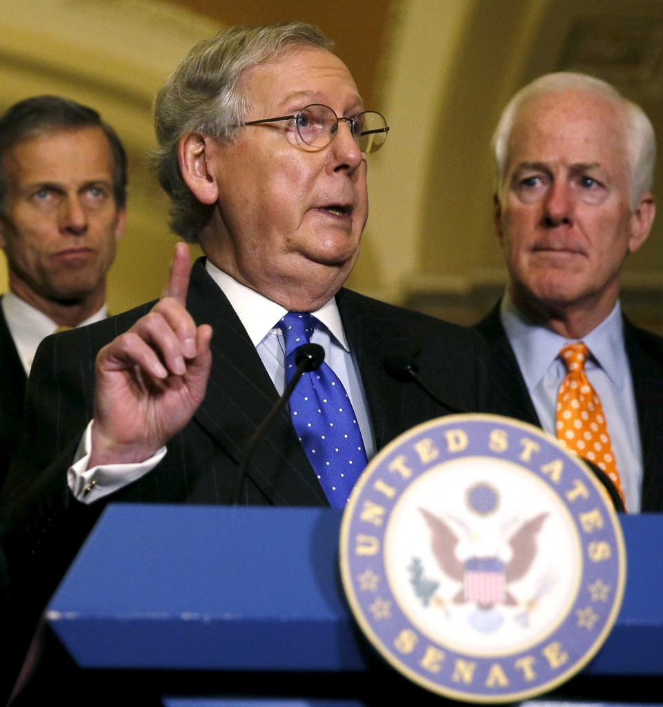 Senate Majority Leader Mitch McConnell (R-KY) (C) addresses a news conference on budget negotiations on Capitol Hill in Washington December 15, 2015. Fellow Republican Sens' John Thune (L), of South Dakota and John Cornyn, from Texas, also participated in the news conference. REUTERS/Gary Cameron