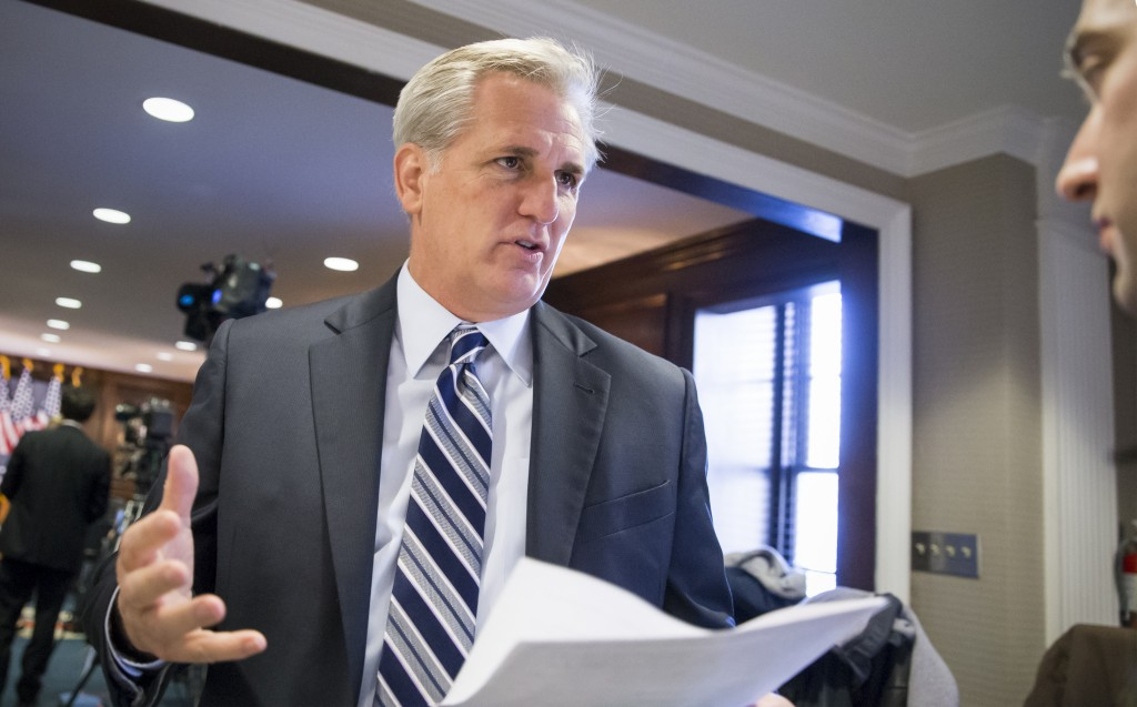 "Majority Leader Kevin McCarthy, R-Calif., speaks with a reporter following a closed-door GOP caucus meeting at the Republican National Headquarters on Capitol Hill in Washington, Tuesday, Dec. 8, 2015. Invoking the Paris terror attacks, House lawmakers pushed toward a vote Tuesday on legislation tightening controls on travel to the U.S. and requiring visas for anyone who's been in Iraq or Syria in the previous five years. ""You have more than 5,000 individuals that have Western passports in this program that have gone to Iraq or Syria in the last five years,"" said McCarthy. ""Those are gaps that we need to fix."" (AP Photo/J. Scott Applewhite)"