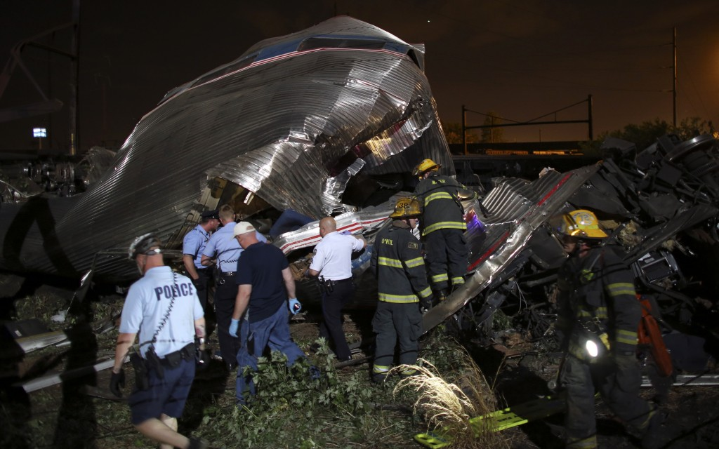FILE - Emergency personnel work at the scene of a deadly train derailment, Wednesday, May 13, 2015, in Philadelphia. The Amtrak train, headed to New York City, derailed and crashed in Philadelphia.  (AP Photo/Joseph Kaczmarek, File)