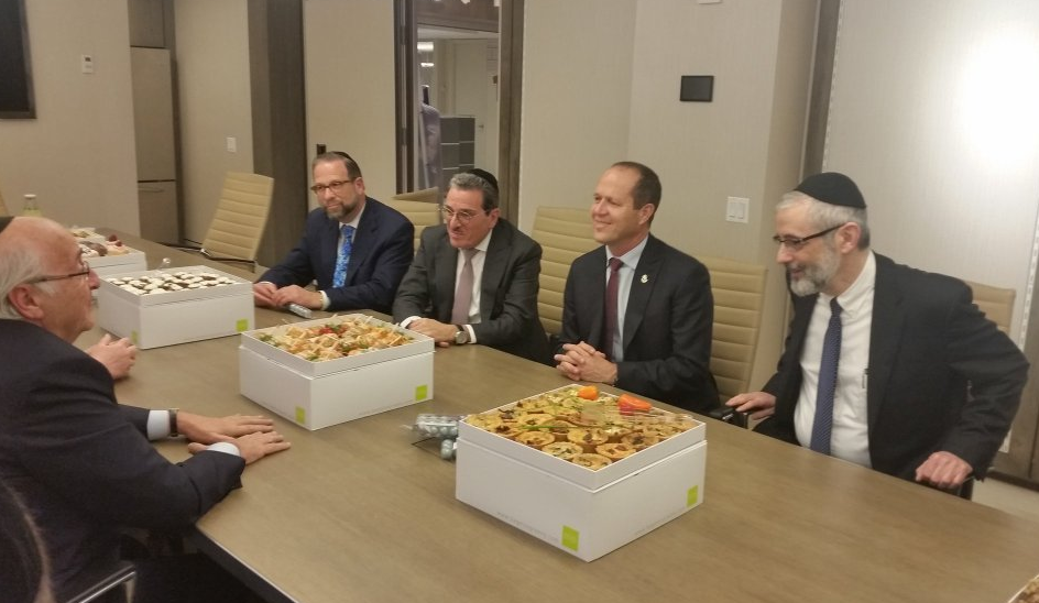 Seated at the far side of the table are (L-R): Leon Goldenberg, Shlomo Werdiger, Mayor Barkat, and Rabbi Zwiebel. On the near side is George Klien.