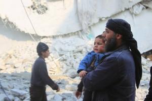 A rescue worker holds an injured boy. (Reuters/Ammar Abdullah)